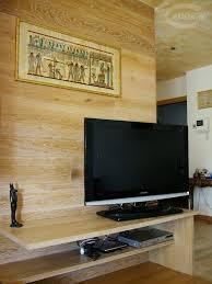 rivestimento in legno pareti moduli disegno a parete di listoni in legno massiccio cadorin