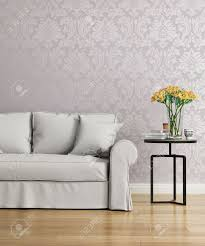Purple Damask Wallpaper by Grey Sofa With A Purple Damask Victorian Wallpaper Stock Photo