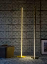 Yumi Floor Lamp Idyllic Black Porcelain Tile Ing Near Brown Wooden Chair 945x945