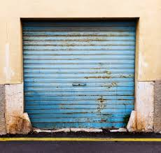 Precision Overhead Garage Doors by Removing Stains From Your Garage Door In Las Vegas
