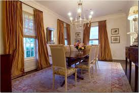 luxury dining room decors with rounded chrome chandelier over