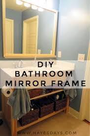 diy day framing a bathroom mirror with storage hayes days