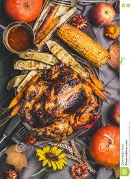 thanksgiving day roasted whole stuffed chicken or turkey served