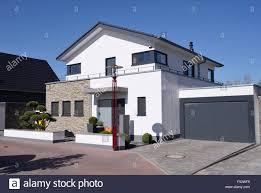 modern house with garage germany north rhine westphalia stock