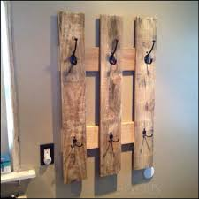 100 uses for reclaimed pallets pallets coat racks and wood art