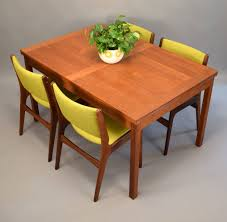 danish teak dining table by ansager mobler with pull out leaves