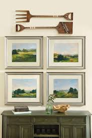 4 ways to hang art above a console how to decorate 4 different looks with wall decor