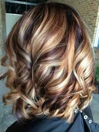 2015 hair color for women autumn swirls cherry cola lowlights with blonde highlights
