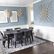 blue painted dining table modern coastal dining area with wainscoting walls that highlight the