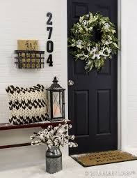 incorporate front door decor that provides a welcoming energy to