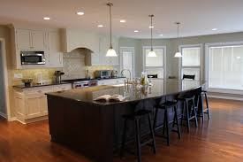 kitchen cozy laminate wood flooring with saddle bar stools and