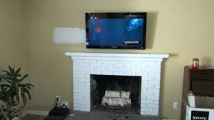 mounting tv above brick fireplace hiding wires install