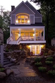 lake front cottage with a stunning staircase story house front