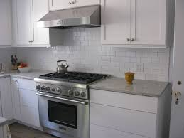 subway tile kitchen dark grout dark brown varnished wooden cabinet