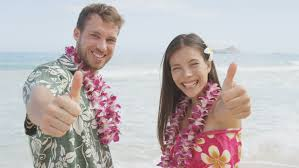 Hawaii travel man images Happy couple of tourists standing on hawaiian beach at their jpg