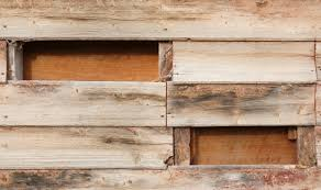 old wood wall with missing planks free background www