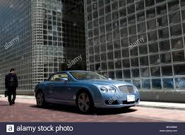 bentley car a japanese man pass by a bentley car in front of maison hermes