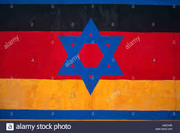 The Germany Flag Graffiti Detail From The Berlin Wall Showing The Israeli Star Of