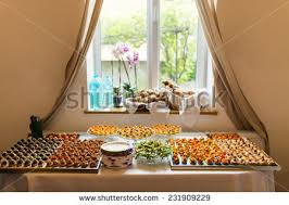 buffet table setting canapes stock photo 231909229
