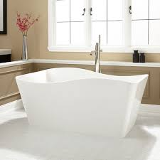 shapeless white stone standing bathtub with on cream marble tiled