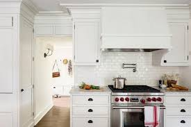 white subway tile kitchen backsplash small kitchen designed with white cabinets and grey subway tile