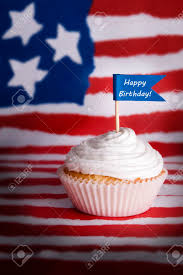 Happy Birthday Flags A Cupcake With A Happy Birthday Flag In It On An American Flag