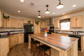 rustic kitchen with knotty pine kitchen cabinets and wood accent