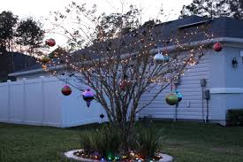 Christmas Topiaries With Lights Holiday Decorating With Oversized Christmas Ornaments