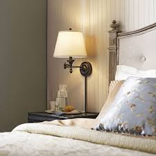 conserve valuable bedside table space by installing a chic and