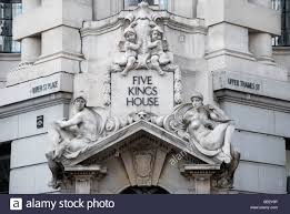 ornamental statues above entrance to five house at 1