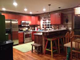 kitchen old beams supporting bar and countertops are granite from