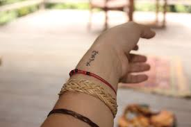 tattoos on the side of the wrist small cross on side of