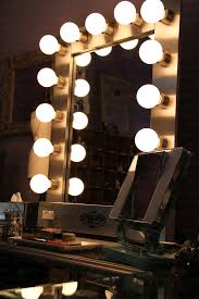 full length mirror with light bulbs or i could go the vanity hollywood mirror route in my awesome