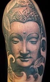 buddha design face tattoo on arm tattoomagz