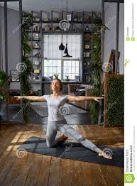 Livingroom Yoga by Woman Practicing Advanced Yoga In The Living Room At Home A
