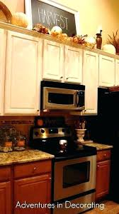 ideas for tops of kitchen cabinets top of kitchen cabinet decor catchy decorating ideas for above