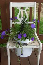 Chair In Garden 127 Best Uses Of Old Chairs In Gardening Images On Pinterest