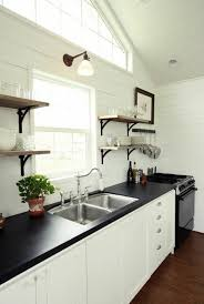 wall colors for white kitchen cabinets black countertops white cabinets with black countertops 12 inspiring designs