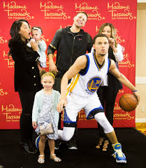 the curry family poses with steph u0027s wax figure at madame tussauds