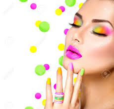 beauty with colorful makeup nail polish and accessories