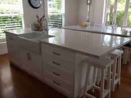 kitchen island with sink and dishwasher and seating rectangular