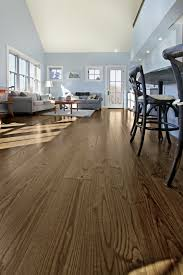 the owners of this timber frame home chose ash wide plank flooring