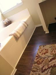 wood and tile floors bathroom traditional with none 1