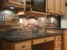 Pictures Of Stone Backsplashes For Kitchens This Natural Slate Tile Backsplash Is Shown With Uba Tuba Granite