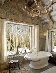 enchanting ideas for the relaxed rustic bathroom antler light and large windows provide balance natural artificial lighting design