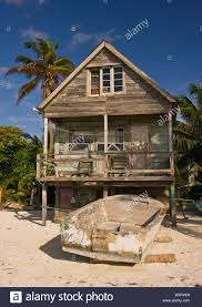 Caye Caulker Belize Old Wooden House On Stilts On Beach With Boat