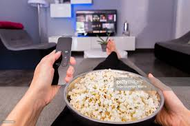 television cuisine low section of with popcorns television while sitting