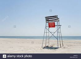 empty lifeguard chair rockaway beach new york usa stock photo