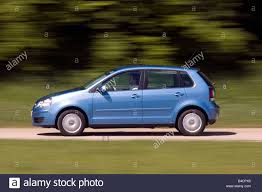car volkswagen side view vw volkswagen polo 1 9 tdi model year 2005 blue moving side