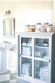 Glass Bathroom Storage Jars Bathroom Cabinet Bathroom Cabinet With Glass Doors Organized